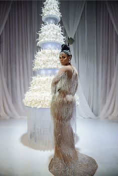 Rapper Gucci Mane married his Jamaican bride Keyshia Ka'oir in her custom Charbel Zoe Couture's glamorous heavily embellished mermaid gown.  And don't forget that extravagant $75,000 custom wedding cake by Edda's Cake Design.c