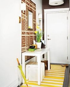 Many of us don't come home to a big foyer, but there are many ways to make the best of what space you do have. With some strategic purchases and placements, small bits of wall or a funny hallway can function as stylish and efficient entry areas.
