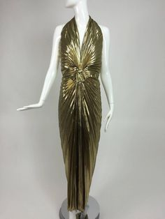 Travilla Marilyn Monroe sunburst pleated gold lame halter neck gown 1953 The original worn by Monroe did not have a zipper in the back, the dress was sewn on to fit her curves...
