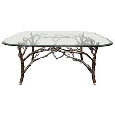 Love it!!  Glass Top Coffee Table with tree leg base