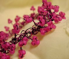 Wire crochet bracelet with hot pink glass seed beads