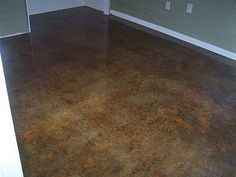 How to Acid Stain Concrete - Alternative Flooring. Our floors were acid stained, but the finish was in rough shape. I stripped the floors with Smart Strip and we have just applied a water-based sealant by Behr to create the wet look - a glossier finish than the floors in this photo.