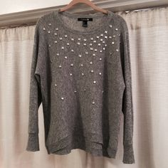 """{ Forever 21 } Grey Embellished Stud Sweater Modern&edgy, yet totally versatile, comfy&warm. Gray knit sweater w/flat plastic studs for sparkle! Rayon, Polyester, Nylon, Wool& other fibers.  Preowned, worn a few times, good condition w/ some pilling (shown in detail pictures). I would've removed the pilling, but my sweater shaver is broken. Approximate Measurements: Waist 38"""" to 40"""" Length shoulder to hem 24"""" front, 25"""" back Sleeve Length 25""""  Will accept reasonable offers. Any questions…"""