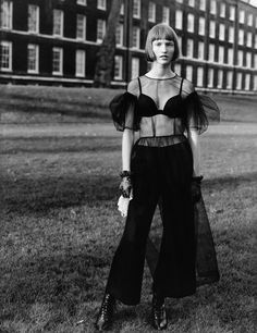 Ina wears dress and trousers Simone Rocha. Gloves The Contemporary Wardrobe Collection. Handkerchief National Theatre Costume Hire.