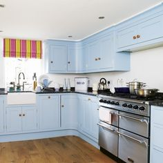 *sigh* I really like the look of painted cabinets, but it's such a commitment.