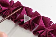 Watch+to+learn+how+to+create+a+beautiful+pleated+trim+from+petersham+ribbon.+