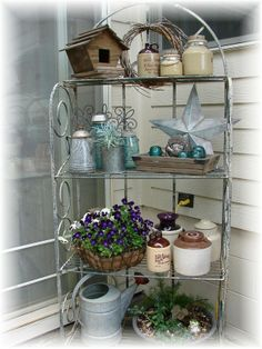 Home Decoration - Ok, I got a baker's rack today for my front porch. Now need ideas of what to.