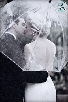 Wedding photo bride and groom in the rain...