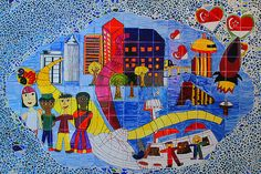 """The title of the mural is """"What Do I Want for Singapore?"""" is display at the Singapore Discovery Centre. This mosaic mural is the work of children attending the Special Art Class Proghramme organised by the Very Special Arts Singapore that promotes op Amazing! you will love this Mosaic sit"""