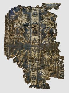 """Fragment of a Band with Noble Equestrian and Soldier, inscribed """"Joseph"""" in Greek or Coptic, 7th–9th century (?). Made in Egypt or Syria (?). Weft-faced compound twill (samit) in blue-violet and beige silk. Byzantine Collection, Dumbarton Oaks, Washington, D.C. (BZ.1956.2)"""