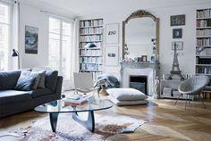 cow hide rug, fireplace, shelves, floor. Bingo.