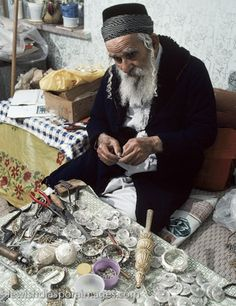 Yemenite Jewish man making traditional gold and silver jewelry and decorations for the Torah, in Jerusalem. The goldsmith is Yossef Zadok, who learned this skill in Yemen and emigrated to Israel in 1949 with many other Yemenite Jews. Mr. Zadok is a 5th generation goldsmith. *I would to sit down and talk to this man for an afternoon, the stories he could tell*