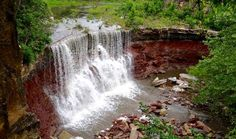 KANSAS The Cowley Lake Waterfall in southeast Kansas can be hard to find. Park in the west-end lot of Cowley County State Fishing Lake and climb down a small path, or drive on the dirt road west of the park, about 200 feet from the falls-feeding river. Vacation Trips, Vacation Spots, Day Trips, Vacation Travel, Vacations, Niagara Waterfall, Fort Leavenworth, Fishing In Canada, Fishing Guide