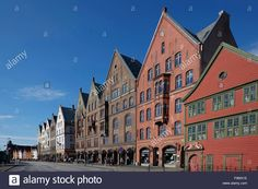 Download this stock image: A historic harbour and port in Bergen ,Bryggen Hanseatic Wharf,  with traditional waterfront buildings, former warehouses. - F9MX1E from Alamy's library of millions of high resolution stock photos, illustrations and vectors.