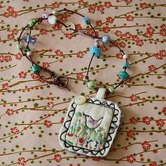 textile pendant  from hens teeth