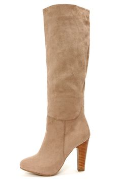 """Ready to embrace boot weather? We sure are in the Dollhouse Embrace Taupe Suede Knee High Heel Boots! Sleek and chic describe these simple vegan suede boots with an almond toe and soft beige upper. A 16"""" slip-on shaft has a 15"""" neck opening that hits just below the knee. Stacked woodgrain heel adds a bit of brown for the perfect two-tone effect, and measures in at an easy 4"""" (including rubber tip). Lightly cushioned insole. Non-skid rubber sole. Available in whole and half size..."""