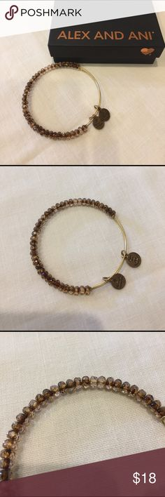 NWOT Alex and Ani bangle NWOT....I cut the tag off in anticipation of wearing it, but never did....in excellent condition!  Alex and Ani bangle with brown beads....perfect for your arm party! Alex & Ani Jewelry Bracelets