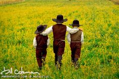 1450 brothers three brothers walk through a field of flowers