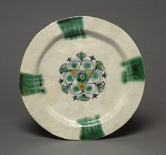 Earthenware Dish Painted Blue with Splashes of Green and Yellow, 830-900 Iraq, Basra, Abbasid period, 9th Century earthenware with overglaze-painted design, Diameter - w:30.20 cm (w:11 7/8 inches) Overall - h:1.30 cm (h:1/2 inches). The Worcester R. Warner Collection 1915.304 Cleveland Museum
