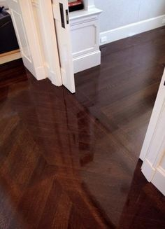 Herringbone wood floors - hallway by sonja