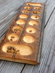 Mancala Game made from old beadboard, use small shells or tumbled rocks to make italic more period.