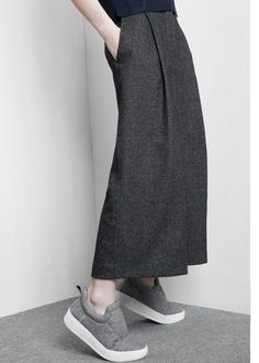 Wool-blend culottes with twin side pockets. Pleats on the front, twin welt pockets at back, hook and buttons fastening.
