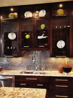 kitchens - glass front espresso stained kitchen cabinets gold granite countertops counter tops blue gray mini subway tiles backsplash back splash chrome faucet fixtures pulls hardware decorative plates under cabinet lighting kitchen