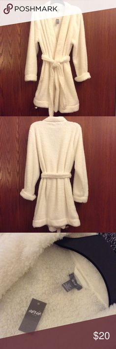 Fluffy cream robe from Aerie! NWT and mid length! So cozy and comfy! Brand new and perfect to cuddle up in this winter! Would make a great gift as well! Smoke free home. 100% polyester. Length is 36 inches. Have questions? Feel free to ask! Offers are welcome using the offer button! Bundle and save. I do not model. No trades. Thanks so much for looking! aerie Intimates & Sleepwear Robes