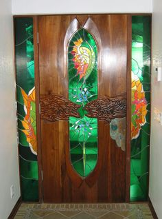 Stained Glass and Carved Wood Interior Door by James Hubbell