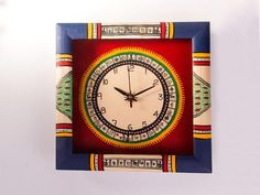 Hand Painted Blue & Red #Warli #WallClock... #Clocks  Price Rs. 1,050 You can buy it here: http://artisangilt.com/handicrafts/furnishing/clocks/hand-painted-blue-red-warli-wall-clock.html