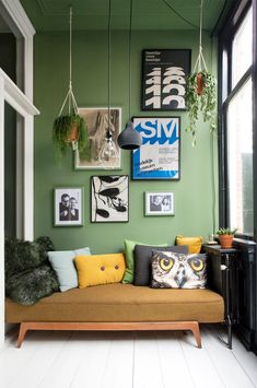 pendant lights and hanging plants with green paint and art gallery wall. / sfgirlbybay