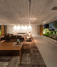By the Pinheiros River in the city of Sao Paulo, huge stacked concrete volumes form the casing of a striking new home, designed by the talent at Brazilian compa