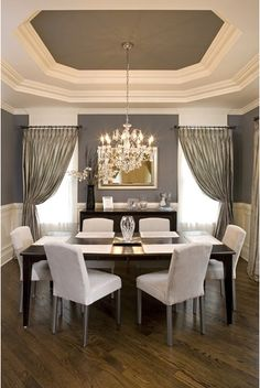 Grey and White Dining Room: the interior of the tray ceiling is painted to match the wall color. I loooove tray ceilings.