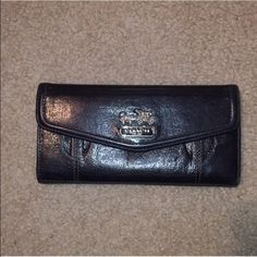 Coach Leather Wallet Coach black leather wallet with tear drop accents, silver hardware and a lavender interior. Gently used. In excellent condition. Matching handbag also for sale. Coach Bags Wallets