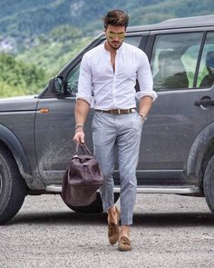Shop this look on Lookastic: https://lookastic.co.uk/men/looks/long-sleeve-shirt-dress-pants-tassel-loafers/20003 — White Long Sleeve Shirt — Brown Leather Belt — Grey Plaid Dress Pants — Dark Brown Leather Holdall — Brown Suede Tassel Loafers — Gold Sunglasses