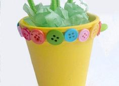 Here is a fun craft to do with the kids.  Put stems in the pot and put pictures on top of the stems. great gift for grandmas