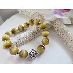 Honey Tiger Eye bracelet, Gemstone bracelet, Sterling Silver stacking... ($35) ❤ liked on Polyvore featuring jewelry, bracelets, tiger eye jewelry, magnetic jewelry, sterling silver bangles, sterling silver jewelry and magnet jewelry