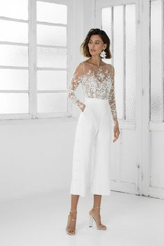 Tailored Braham Rime Arodaky white bridal jumpsuit with flare trousers. Naked skin bodice with delicate embroidered flowers. Wedding Rehearsal Outfit, Rehearsal Dinner Outfits, Casual Wedding, Wedding Suits For Bride, Wedding Trouser Suits, Wedding Pantsuit, Courthouse Wedding Dress, Civil Wedding Dresses, Bridal Outfits
