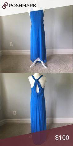 Alice and Olivia dress. Gorgeous blue dress 96% silk 4% spandex. Worn 3 times. Alice and Olivia Dresses High Low