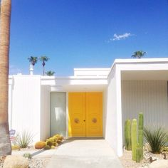 Bright Yellow Front Door in Palm Springs, California // via kellygolightly