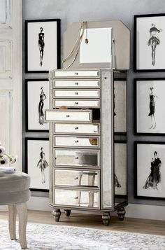 This piece is the ultimate in jewelry storage. With antiqued mirror detailing, its 10 drawers feature anti-tarnish velvet lining, while each side compartment contains 40 hanging hooks. Top lifts to reveal an interior mirror and additional storage compartments so every accessory you own is at the ready.Glass Mirror, engineered wood, birch veneer, and velvet Elegant soft silver painted finish Antiqued mirror detail8 drawers with velvet liningSides Loren Jewelry Cabinet Big Jewelry, Jewelry Logo, Tarnished Jewelry, Jewelry Cabinet, Jewellery Storage, Jewelry Organization, Storage Compartments, Closet Storage, Engineered Wood