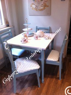 Retro country style table and 4 chairs , duckegg blue with duckegg blue and white polka dot PVC chair covers . #painted furniture ideal for a tea party