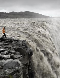Dettifoss Waterfall, Iceland:   Would NOT recommend going this close to the edge... People have fallen into icelandic waterfalls before, doing exactly this, and not survived... :/