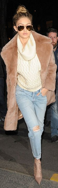 Who made  Gigi Hadid's blue ripped jeans, cage ankle boots, tan coat, gold aviator sunglasses, and ribbed white sweater?