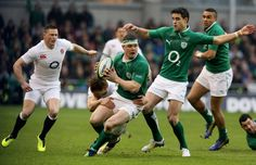 Brian O'Driscoll of Ireland looks for support as he is tackled by Billy Twelvetrees of England during the RBS Six Nations match between Ireland and England at Aviva Stadium on February 10, 2013 in Dublin, Ireland.