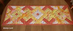 Orange and yellow table topper / Frühlingsläufer aus Jelly-Rolls