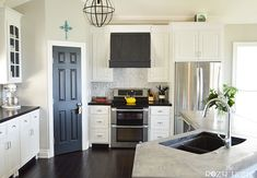 Gorgeous kitchen makeover. Love the DIY range hood and counters.