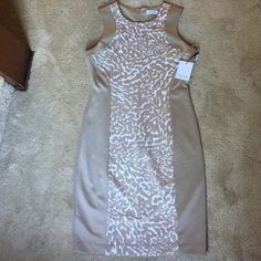 Calvin Klein dress NWT!! This is a gorgeous Calvin Klein dress! 93%polyester 7%soandex so it fits great against your body!! Tan and white in color!! Calvin Klein Dresses