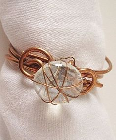 Copper Napkin Rings Wire Wrapped Clear Glass Beads 8 Coiled. Set of 8 wire wrap napkin rings are made from copper coated aluminum wire and wire wrapped glass beads. Since each napkin ring is done by hand they may vary from the picture and slightly from each other but will remain true to the design. Makes a great wedding gift, hostess gift or just for general use.