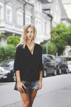 Loose black blouse + short shorts.